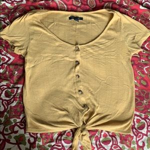 Gold American eagle crop top with bow